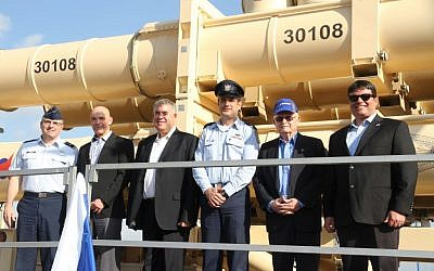 From right, Moshe Patel, head of the Defense Ministry's missile program, David Ivri, president of Boeing-Israel, Brig. Gen. Tzvika Haimovitch, head of the army's Aerial Defense Command, Boaz Levi, vice president of IAI's missile division, Danny Gold, the former head of the ministry's missile program, and Brig. Gen. William Cooley, of the US Air Force, stand in front of a Arrow 3 missile defense system that was delivered to the Israeli Air Force on January 18, 2017. (Defense Ministry)