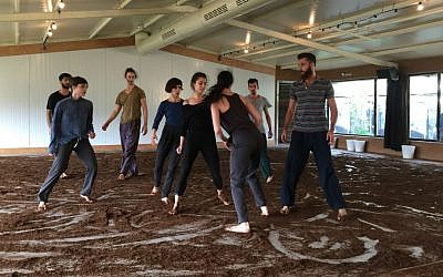 "Eight members of modern dance troupe Vertigo show part of their newest piece, 'One. One and One,"" created in celebration of the group's 25th anniversary celebration (Jessica Steinberg/Times of Israel)"