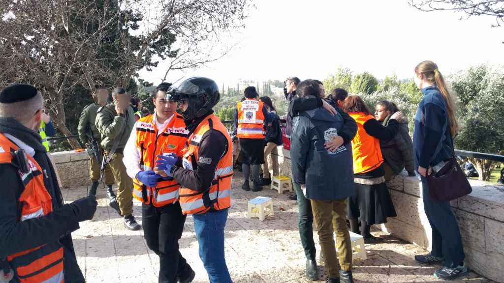 United Hatzalah volunteers trained in psycho-social trauma support help witnesses on January 8, 2017, in the wake of a truck ramming attack in Jerusalem. (Melanie Lidman/Times of Israel)