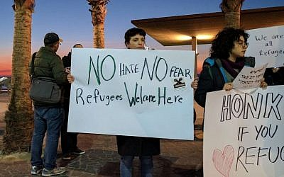 Forty protesters outside the American Embassy in Tel Aviv protested President Donald Trump's policies towards Muslims and refugees on January 29, 2017. (Melanie Lidman/Times of Israel)