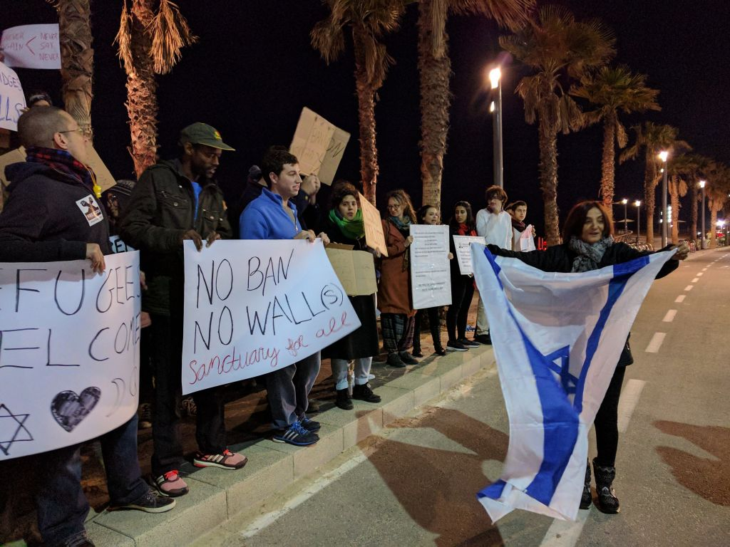 Activists from the Central Bus Station Neighborhood Watch came to show their support to closing the border to refugees, as Israel did with the Egypt border, on January 29, 2017 outside the American embassy in Tel Aviv. (Melanie Lidman/Times of Israel)
