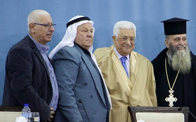 Israeli religious leaders pose for a photo with Palestinian Authority President Mahmoud Abbas at the PA headquarters in Ramallah on January 5, 2017. (Dov Lieber/Times of Israel)