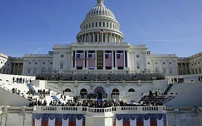 In this Jan. 15, 2016, photo, the US Capitol frames the backdrop over the stage during a rehearsal of President-elect Donald Trump's swearing-in ceremony in Washington. (AP Photo/Patrick Semansky)