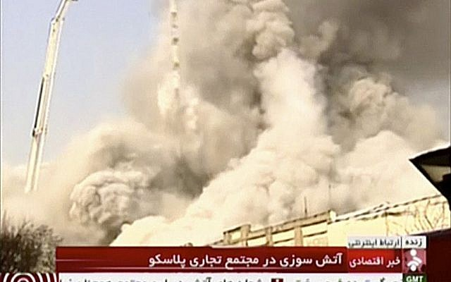 In this image made from video, a high-rise residential building collapses following a large fire, Thursday, Jan. 19, 2017, in Tehran, Iran. (IRINN via AP)