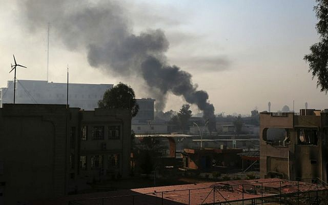Smoke rises as Iraqi security forces fight against Islamic State inside Mosul University, in the eastern side of Mosul, Iraq, Saturday, Jan. 14, 2017. (AP Photo/Khalid Mohammed)