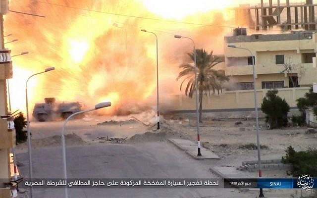 This photo posted on a file sharing website Wednesday, Jan. 11, 2017, by the Islamic State Group in Sinai, a terrorist organization, shows an explosion as terrorists attack an Egyptian police checkpoint on Monday, Jan. 9, 2017, in el-Arish, north Sinai, Egypt. (Islamic State Group in Sinai, via AP)