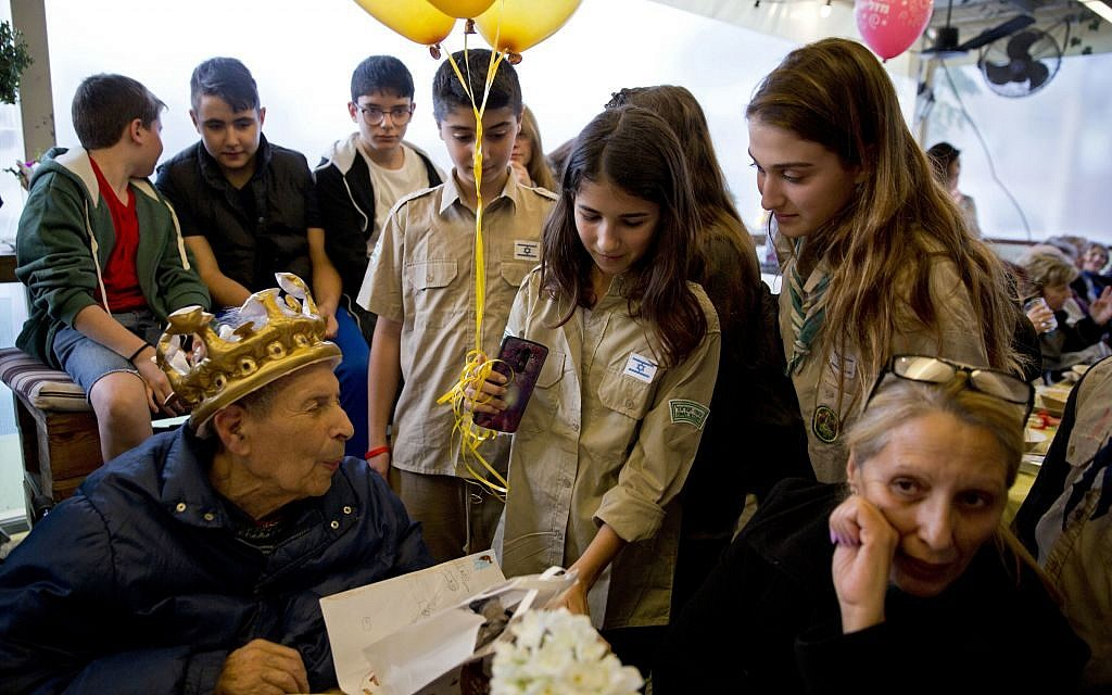 Holocaust survivor Ernest Weiner is visited by scouts during his 92nd birthday in a restaurant in the central Israeli city of Ramat Hasharon on  Jan. 24, 2017. (AP Photo/Sebastian Scheiner)