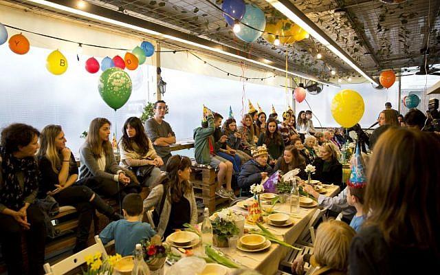 Holocaust survivor Ernest Weiner celebrates his 92nd birthday in a restaurant in the central Israeli city of Ramat Hasharon on Jan. 24, 2017. (AP Photo/Sebastian Scheiner)
