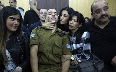 In this Wednesday, Jan. 4, 2017 file photo, Israeli soldier Sgt. Elor Azaria waits with his parents for the verdict inside the military court in Tel Aviv, Israel. (Heidi Levine, Pool via AP)