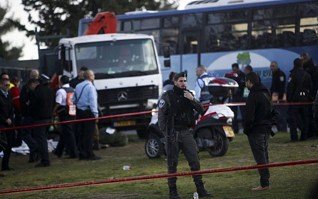 Israeli police at the scene of a terror attack in Jerusalem Sunday, Jan. 8, 2017. A Palestinian rammed his truck into a group of Israeli soldiers, killing four and wounding 16 others (AP Photo/Mahmoud Illean)