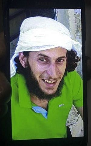 A relative shows a mobile phone photo of Fadi Qunbar, 28, outside his home in Jerusalem, Sunday, Jan. 8, 2017. Qunbar was identified as the terrorist who drove a truck into a group of Israeli soldiers, killing four and wounding 16 (AP Photo/Mahmoud Illean)