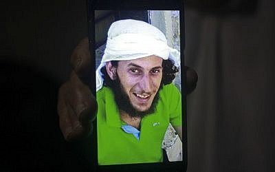 A relative shows a mobile phone photo of Fadi Qunbar, 28, outside his home in Jerusalem, Sunday, Jan. 8, 2017. Qunbar was identified as the terrorist who drove a truck into a group of Israeli soldiers, killing four and wounding 16 others (AP Photo/Mahmoud Illean)