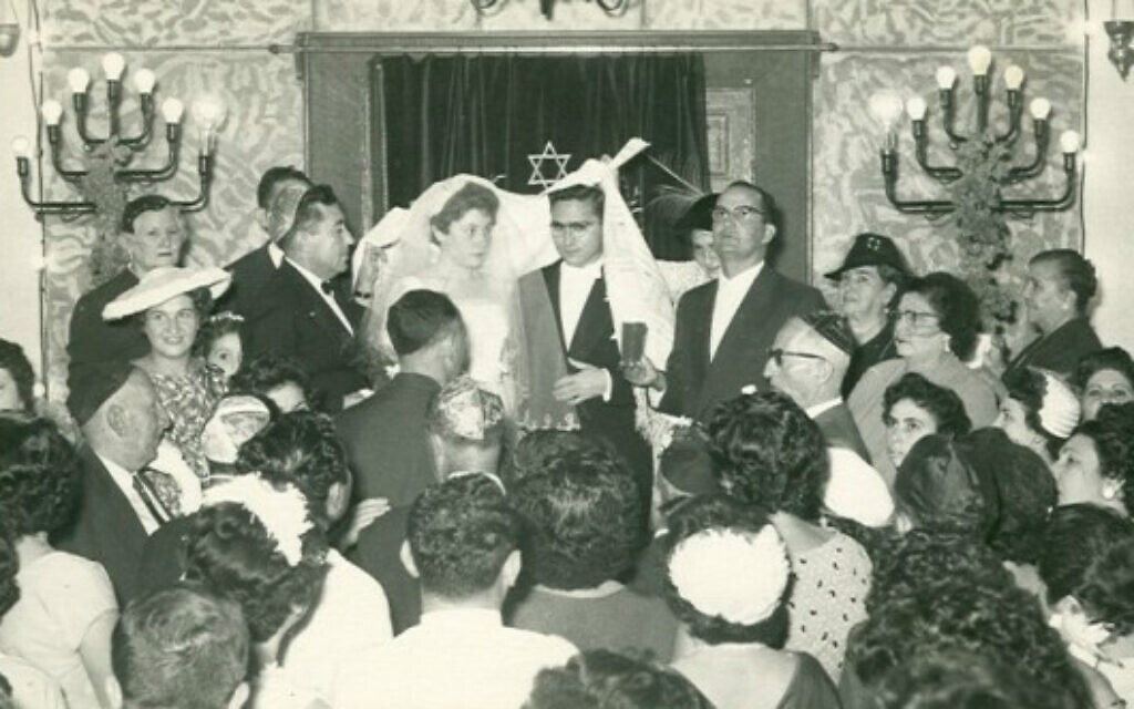 A Jewish wedding is held in Khartoum synagogue, Sudan, 1950. The center of Jewish religious life, the synagogue was established in 1926 in downtown Khartoum, replacing an older small one, and was destroyed in 1987 after serving as a bank. (Photo courtesy of Flore Eleini, Tales of Jewish Sudan, via AP)
