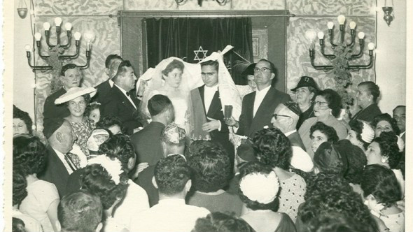 In this 1950 handout photo, provided by Tales of Jewish Sudan, a Jewish wedding is held in Khartoum synagogue, Sudan. The center of Jewish religious life, the synagogue was established in 1926 in downtown Khartoum, replacing an older small one. The synagogue was sold in 1987 after most Sudanese Jews left the country and currently is a bank. (Photo courtesy of Flore Eleini, Tales of Jewish Sudan, via AP)