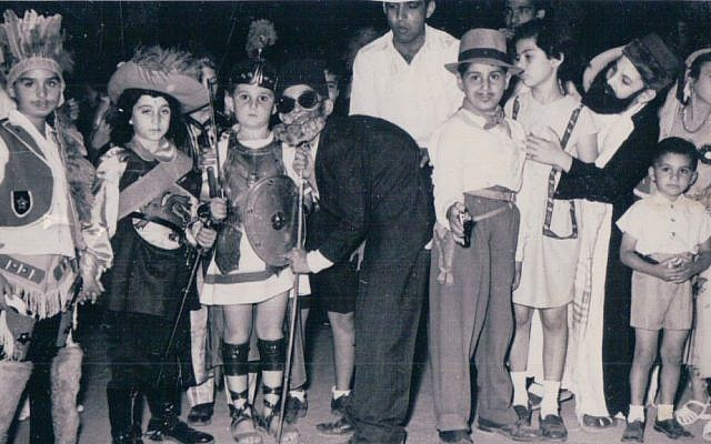 In this undated handout photo, provided by Tales of Jewish Sudan, children attend an annual Purim party, a Jewish holiday, at the Jewish Recreational Club in downtown Khartoum, Sudan. The club was a center for Sudanese Jewish social life. (Photo courtesy of Jack Tamman, Tales of Jewish Sudan, via AP)