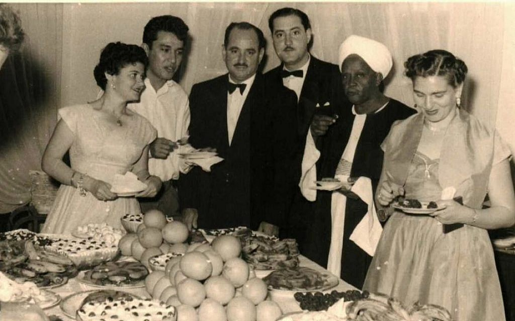 In this undated photo, partygoers pose for a photo at Habib Cohen's (center) house, who regularly served as President of the Jewish community in Khartoum. Many Sudanese Jews had warm relations with their Sudanese Muslim and Christian neighbors and exchanged visits during social events and holidays. (Photo courtesy of Vivien Gilliard/ Tales of Jewish Sudan/ via AP)