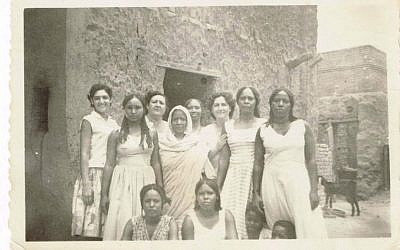 In this undated handout photo, provided by Tales of Jewish Sudan, Lily Ben-David, far left, along with mother and aunt (back row) attend a neighbor's wedding in Khartoum. (Courtesy of Lily Ben-David, Tales of Jewish Sudan, via AP)