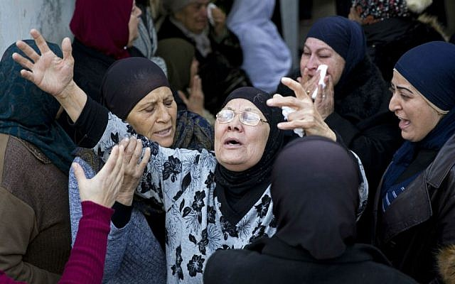 Family and friends of 18-year-old Leanne Nasser, who was killed in the New Year's Eve terror attack in Istanbul, mourn during her funeral in the town of Tira in northern Israel, Tuesday, Jan. 3, 2017. (AP Photo/Ariel Schalit)