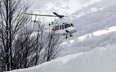 A rescue helicopter approaches the area in Rigopiano, central Italy, where a hotel was buried under an avalanche on Wednesday, to recover 6 people who have been reportedly extracted alive from the debris, Friday, Jan. 20, 2017. (AP Photo Gregorio Borgia)