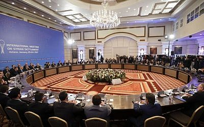 Delegations of Russia, Iran and Turkey hold talks on Syrian peace at a hotel in Astana, Kazakhstan, Monday, January 23, 2017. (AP Photo/Sergei Grits)