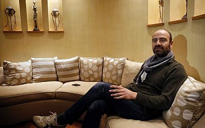 Kinan Azmeh, 40, a Syrian musician who is one of thousands of valid US green card holders who have found their immigration status in limbo after Trump's order Friday, gives an interview to The Associated Press, in Beirut, Lebanon, Sunday, Jan. 29, 2017. (AP Photo/Hussein Malla)