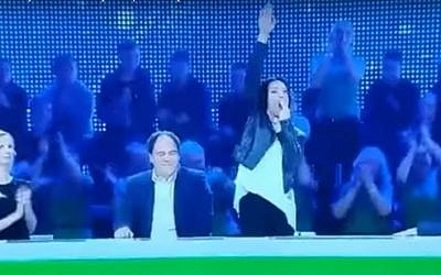 Screen capture from video showing actress Asta Baukute, a former lawmaker, gives a Nazi-style salute on the Lithuanian 'Guess the Melody' game show, January 2017. (YouTube/Manciusz)