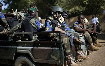 In this file photo taken on Sunday Nov. 24, 2013, the Malian army patrol the streets of Gao, Northern Mali. (AP Photo/Jerome Delay, File)