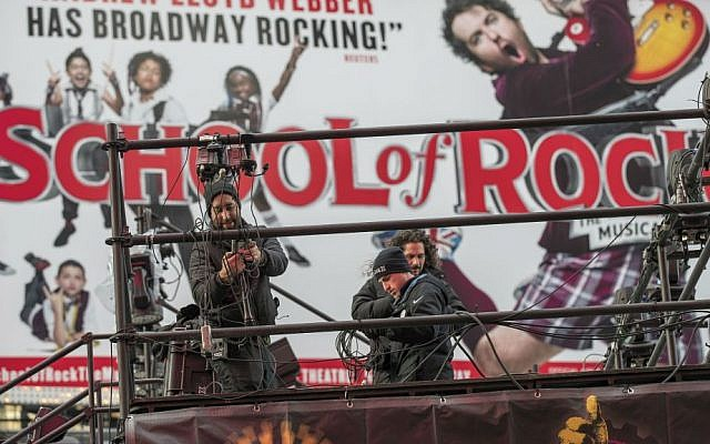 Technicians prepare a stage that will be used in the New Year's celebrations, Friday, Dec. 30, 2016, in New York's Times Square. (AP Photo/Mary Altaffer)