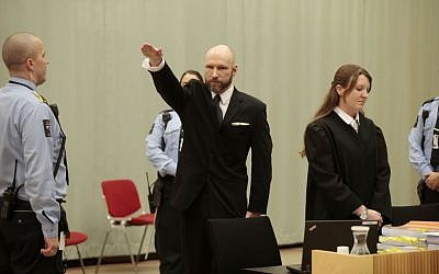 Anders Behring Breivik raises his right hand at the start of his appeal case in Borgarting Court of Appeal at Telemark prison in Skien, Norway, Tuesday, Jan. 10, 2017.  (Lise Aaserud/NTB Scanpix via AP)