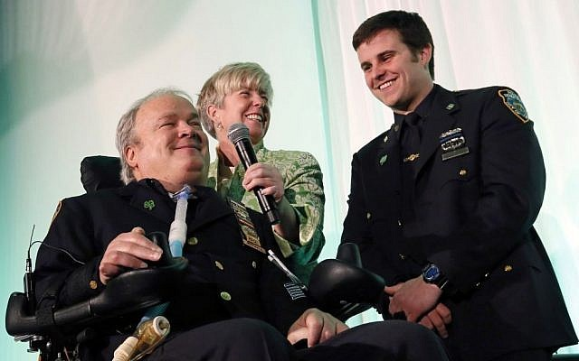 New York City Detective Steven McDonald, his wife Patti, and son, Conor, smile after receiving the Spirit of Giving Award at the Kelly Cares Foundation's 5th Annual Irish Eyes Gala held at the JW Marriot Essex House in New York, March 15, 2015. (Stuart Ramson/Invision for Kelly Cares Foundation/AP Images)