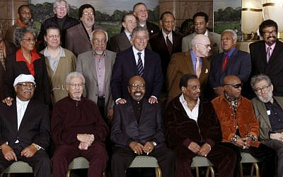 In this Friday, Jan. 13, 2006 file photo, Jazz legends pose for a group portrait of National Endowment for the Arts Jazz Masters of the past and present, in New York. At foreground right is writer Nat Hentoff, who died on Saturday, Jan. 7, 2017. (AP Photo/Bebeto Matthews)