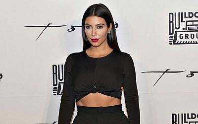 In this Nov. 24, 2014, file photo, Kim Kardashian poses for photographers on her arrival at Toko restaurant in downtown Dubai, United Arab Emirates. (AP Photo/Chito Pachica, File)