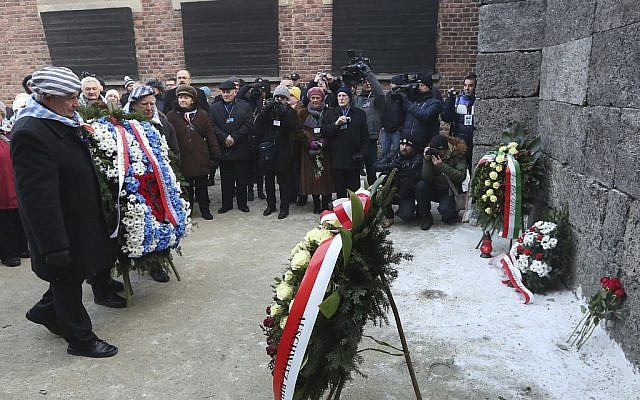 Holocaust survivors commemorate the people killed by the Nazis at Auschwitz in Oswiecim, Poland, Friday, Jan. 27, 2017, on the International Holocaust Remembrance Day, the anniversary of the 1945 liberation of the Nazi death camp. (AP Photo/Czarek Sokolowski)