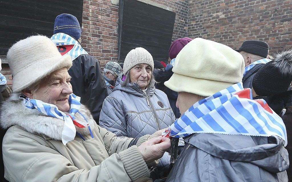Holocaust survivors commemorate people killed by the Nazis at the Auschwitz Nazi death camp in Oswiecim, Poland, Friday, Jan. 27, 2017, on the International Holocaust Remembrance Day that marks the liberation of the Auschwitz Nazi death camp on Jan. 27, 1945. (AP Photo/Czarek Sokolowski)