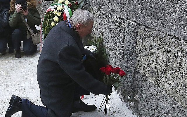 A Holocaust survivor places flowers in commemoration of the people killed by the Nazis at Auschwitz in Oswiecim, Poland on Jan. 27, 2017, the anniversary of the 1945 liberation of the Nazi death camp and International Holocaust Remembrance Day. (AP Photo/Czarek Sokolowski)