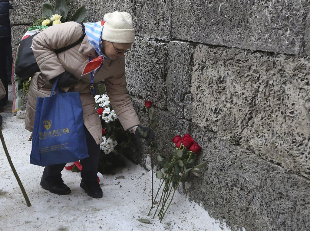 A Holocaust survivor commemorates the people killed by the Nazis at the former Auschwitz Nazi death camp in Oswiecim, Poland, Friday, Jan. 27, 2017, on the International Holocaust Remembrance Day that marks the liberation of the Auschwitz Nazi death camp on Jan. 27, 1945. (AP Photo/Czarek Sokolowski)