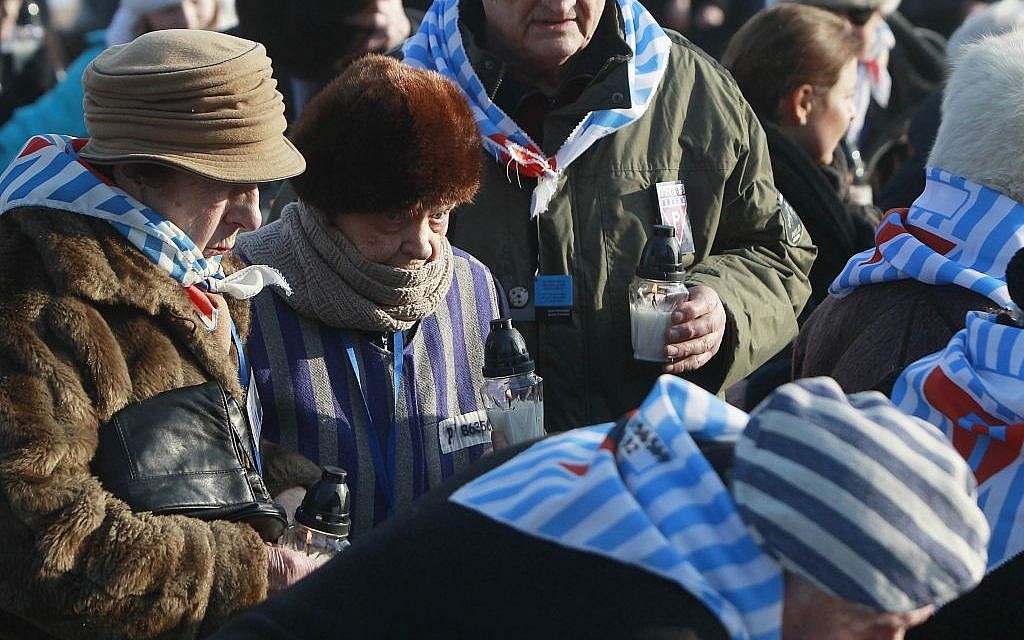 Holocaust survivors light candles at the International Monument to the Victims of Fascism, after a ceremony marking the 72nd anniversary of the liberation of the Nazi death camp Auschwitz-Birkenau, in Oswiecim, Poland, Friday, Jan. 27, 2017, on the International Holocaust Remembrance Day. (AP Photo/Czarek Sokolowski)