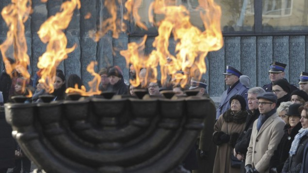 People watch ceremonies marking the International Holocaust Remembrance Day, at the Warsaw Ghetto Uprising memorial in Warsaw, Poland, Friday, Jan. 27, 2017. (AP Photo/Alik Keplicz)
