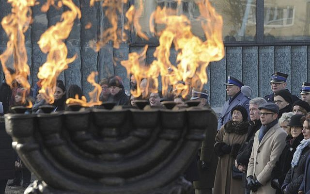 People watch ceremonies marking the International Holocaust Remembrance Day, at the Warsaw Ghetto Uprising memorial in Warsaw, Poland, Friday, January 27, 2017. (AP Photo/Alik Keplicz)