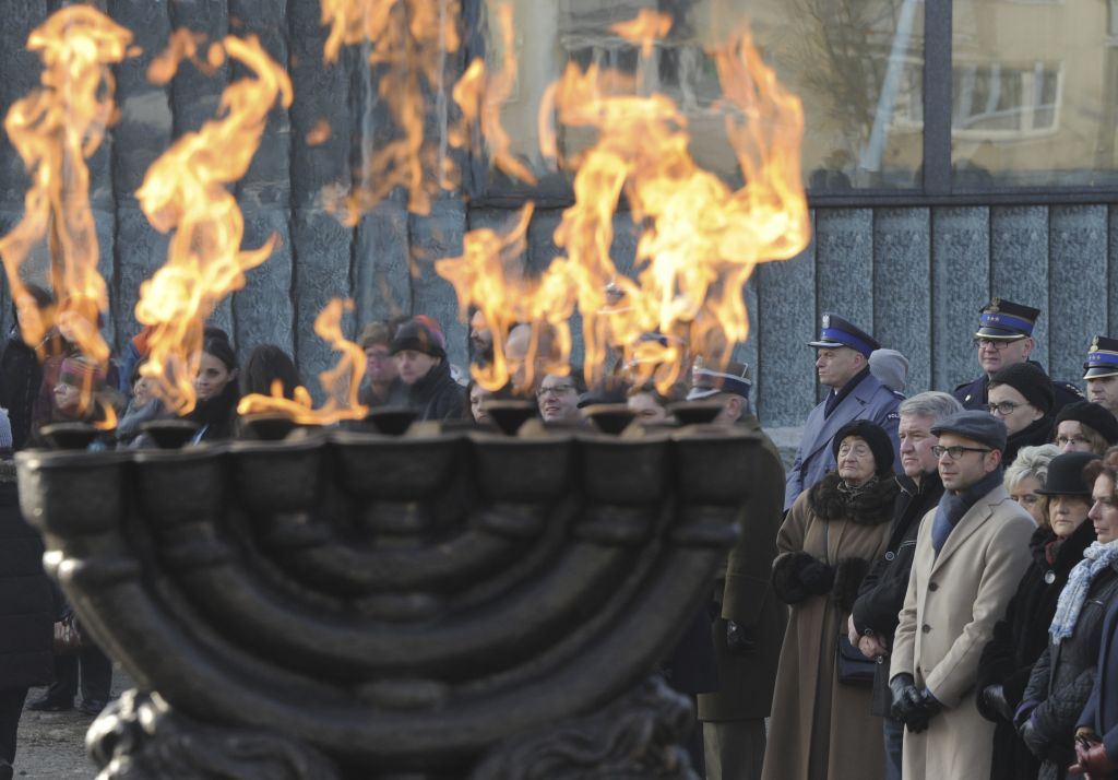 People watch ceremonies marking the Holocaust Remembrance Day, at the Warsaw Ghetto Uprising memorial in Warsaw, Poland, Friday, Jan. 27, 2017. (AP Photo/Alik Keplicz)