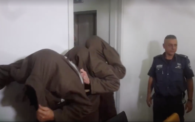 Muhammad Shinawi, Khaled bin Atef Abu Kleib and Ihab bin Ayoub Yusef‬ enter a Haifa court on January 30, 2017. Shinawi is accused of murder and attempted murder for shooting attacks in the northern port city earlier this month. Abu Kleib and Yusef are charged with assisting him. (Screen capture)