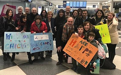 Members of Am Shalom welcoming a Syrian refugee family at O'Hare International Airport in Chicago, Jan. 27, 2017. (Courtesy Am Shalom)