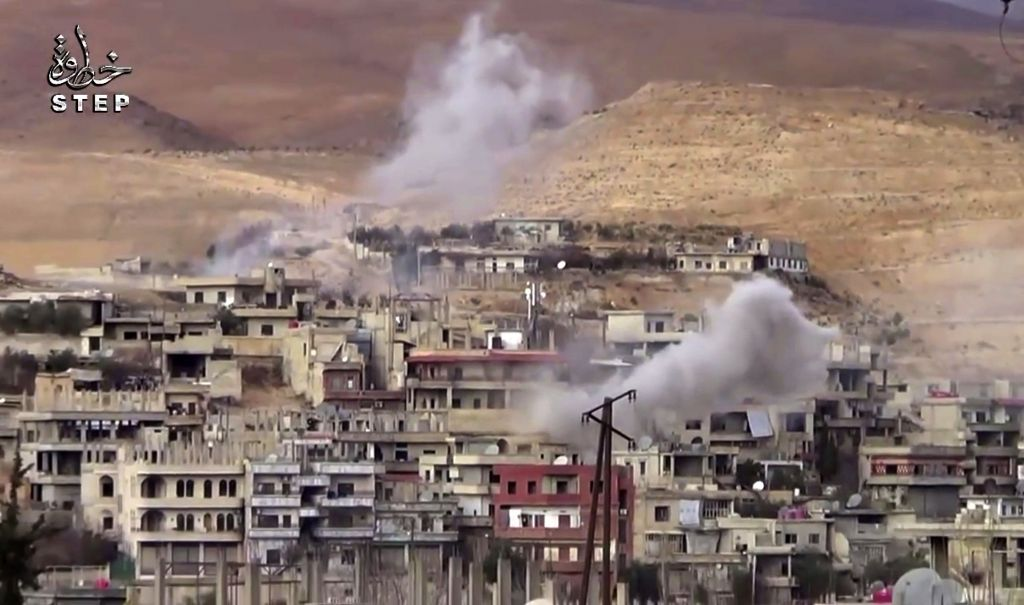 This file frame grab from video provided on Sunday, Dec. 25, 2016 by Step News Agency, a Syrian opposition media outlet that is consistent with independent AP reporting, shows smoke rise from the government forces shelling on Wadi Barada, northwest of Damascus, Syria. (Step News Agency, via AP, File)