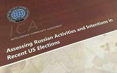 A part of the declassified version Intelligence Community Assessment on Russia's efforts to interfere with the US political process is photographed in Washington on Jan. 6, 2017. (AP Photo/Jon Elswick)