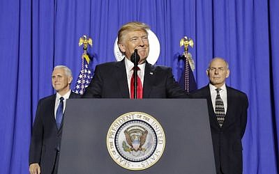 President Donald Trump, accompanied by Vice President Mike Pence, left, and Homeland Security Secretary John F. Kelly, speaking at the Homeland Security Department in Washington, January 25, 2017. (AP Photo/Pablo Martinez Monsivais)