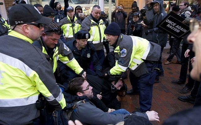 Police try to remove demonstrators from attempting to block people entering a security checkpoint, Friday, Jan. 20, 2017, ahead of President-elect Donald Trump's inauguration in Washington. ( AP/Jose Luis Magana)