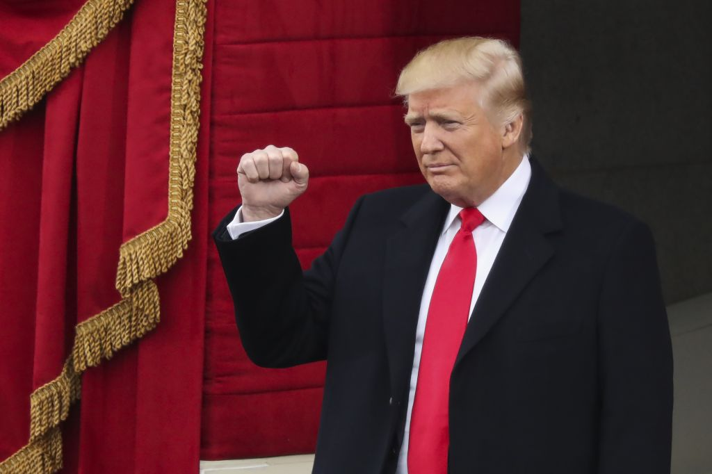 President-elect Donald Trump pumps his fist as he arrives for the 58th Presidential Inauguration at the U.S. Capitol in Washington, Friday, Jan. 20, 2017. (AP Photo/Andrew Harnik)