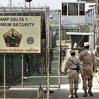 US military guards walk within Camp Delta military-run prison, at the Guantanamo Bay US Naval Base, Cuba,  June 27, 2006. (AP Photo/Brennan Linsley, file)