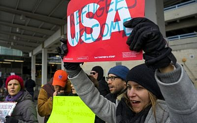 After two Iraqi refugees were detained while trying to enter the country, protesters assemble at John F. Kennedy International Airport in New York, January 28, 2017. (AP/Craig Ruttle)