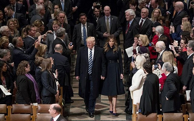 US President Donald Trump, accompanied by First Lady Melania Trump, arrive for a National Prayer Service at the National Cathedral, in Washington, Saturday, Jan. 21, 2017. (AP Photo/Andrew Harnik)